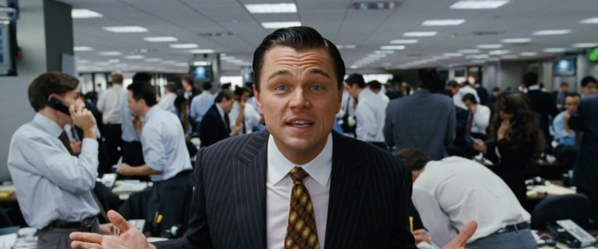 Leonardo DiCaprio looks at the camera in his role as Jordan Belfort, aka the wolf of wall street