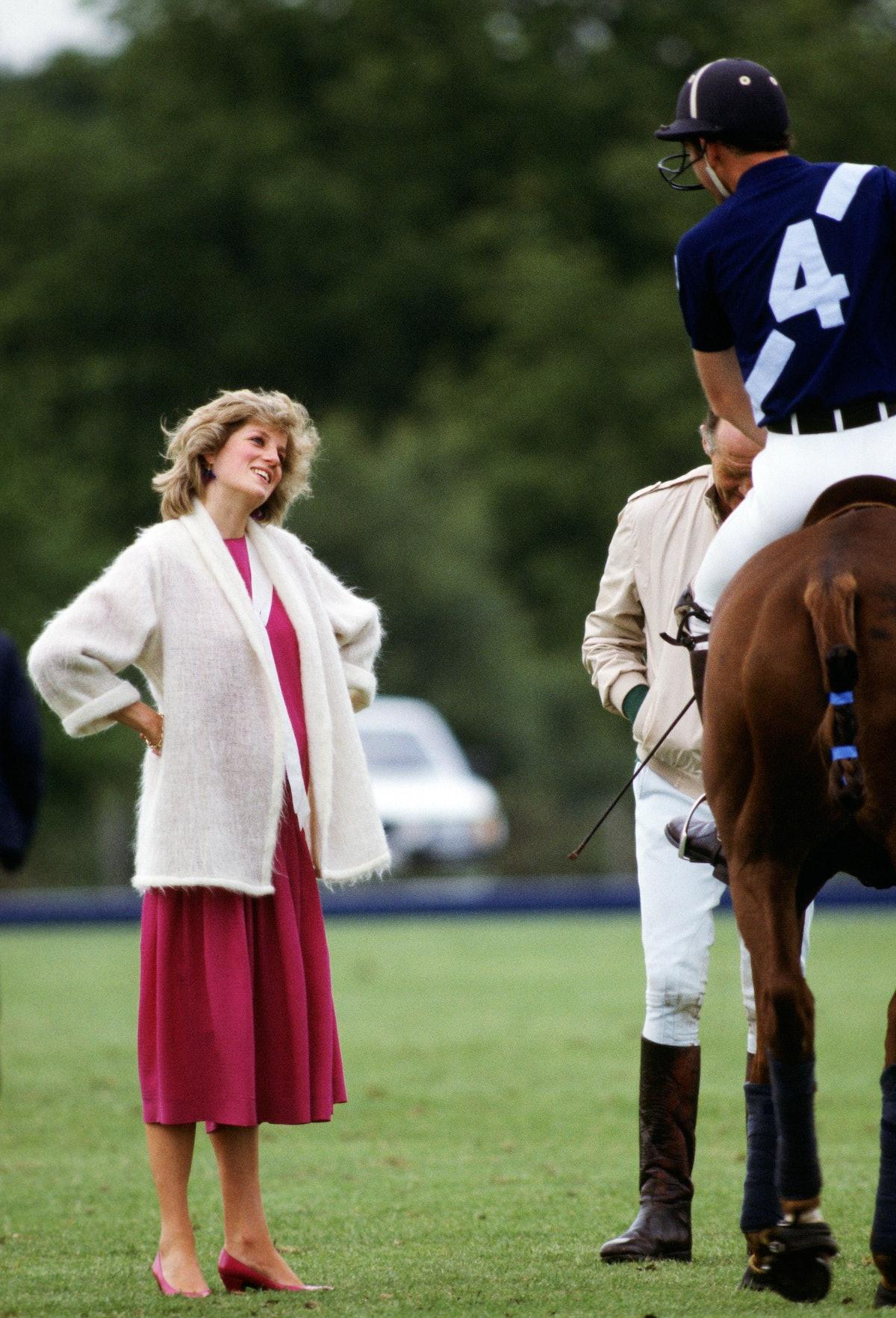 Princess Diana smiling up at Charles