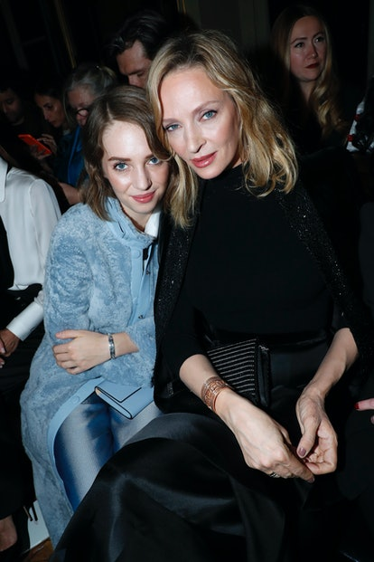 Maya Hawke and Uma Thurman in the front row of a 2019 Armani Privé show