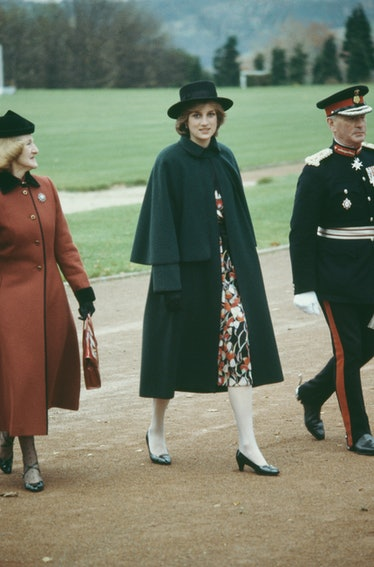 Princess Diana looking chic in an emerald coat