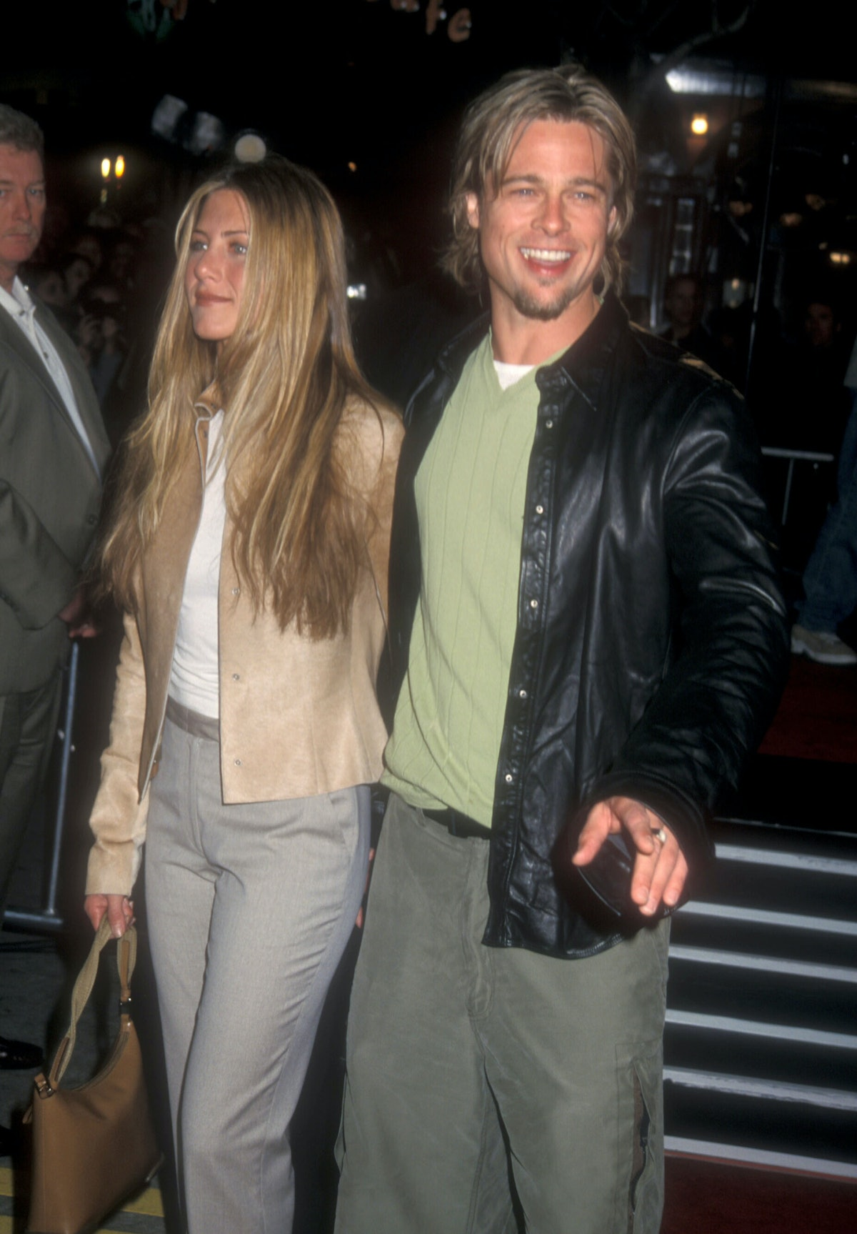 Aniston and Pitt, wearing a green sweater vest