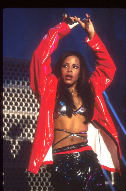 Black style icon Aaliyah performs at The Forum in baggy trousers and a bralette.