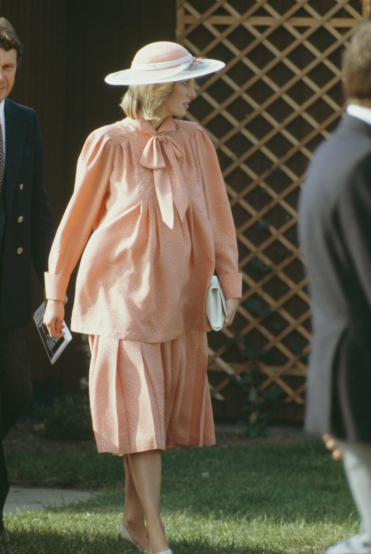 Princess Diana wearing a salmon two-piece