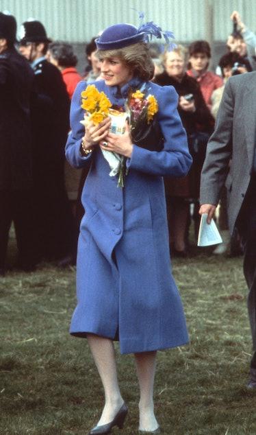 Princess Diana clutching a bouquet