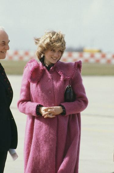 Princess Diana wearing a pink fuzzy coat