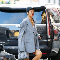 Rihanna wears Goyard Croisiere bag while out and about in New York City on June 29, 2021. She paired it with Junya Watanabe jacket, Luis De Javier pumps, and a R13 baseball cap.
