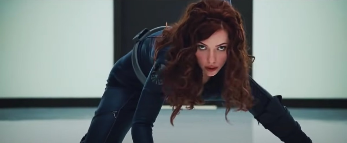 Black Widow lunging in her pose from the Marvel Cinematic Universe films about to say a Black Widow ...
