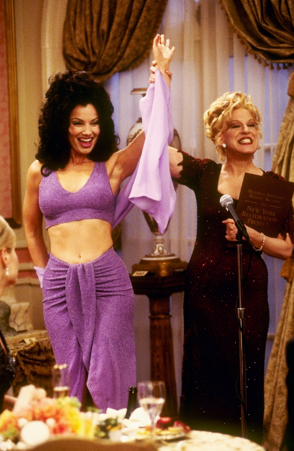 The nanny's Fran Fine wearing a two piece purple shimmer set styled by costume designer Brenda Coope...