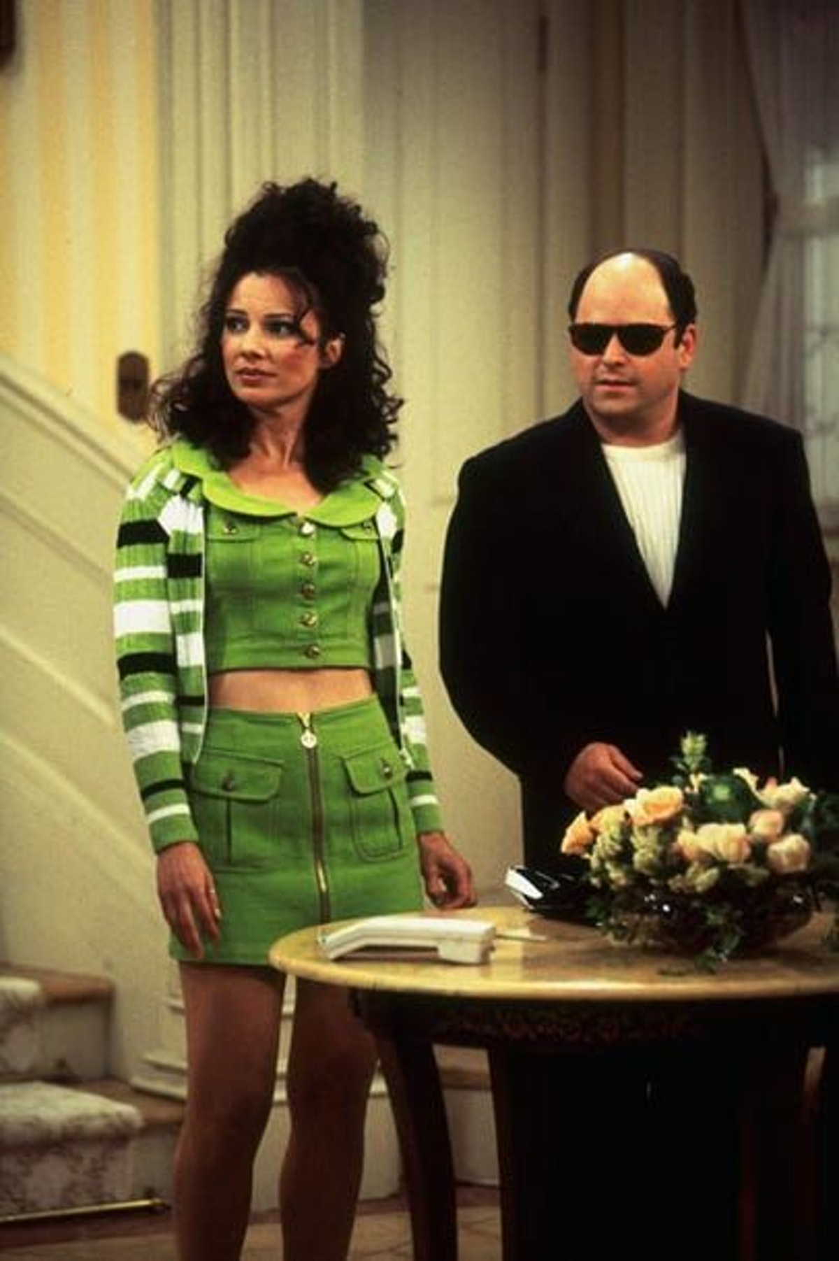 The Nanny's Fran Fine wearing a matching green two-piece set, styled by costume designer Brenda Coop...