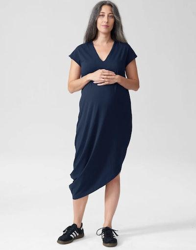 soft navy maternity dress with cap sleeves and an asymmetrical hem