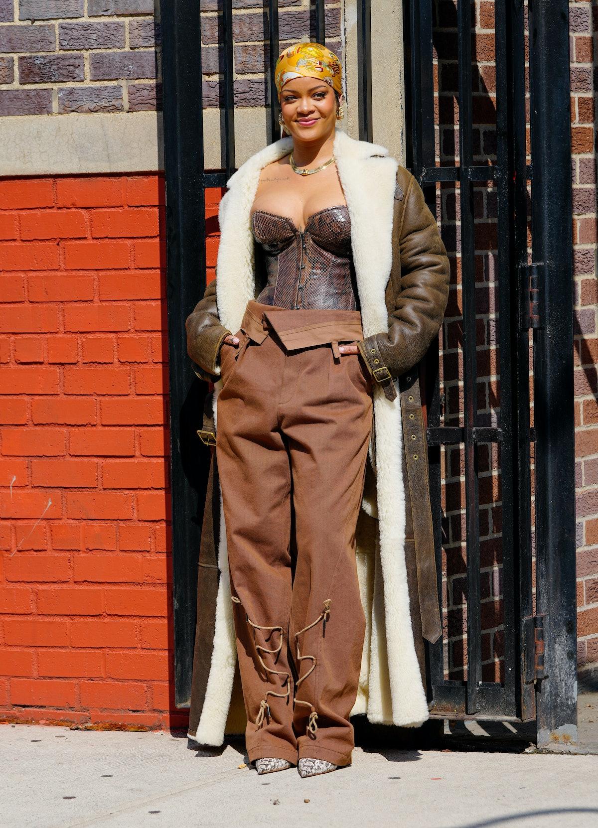 Rihanna in brown coat.