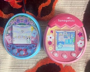 Blue Tamagotchi On Wonder Garden is shown next to pink Tamagotchi Pix