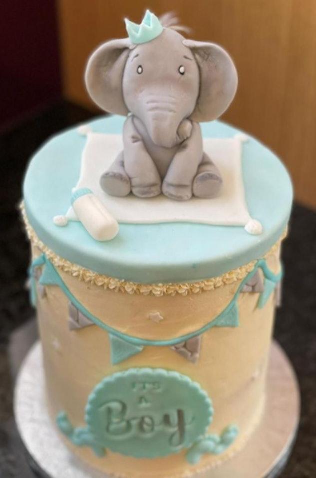 An elephant baby boy shower cake