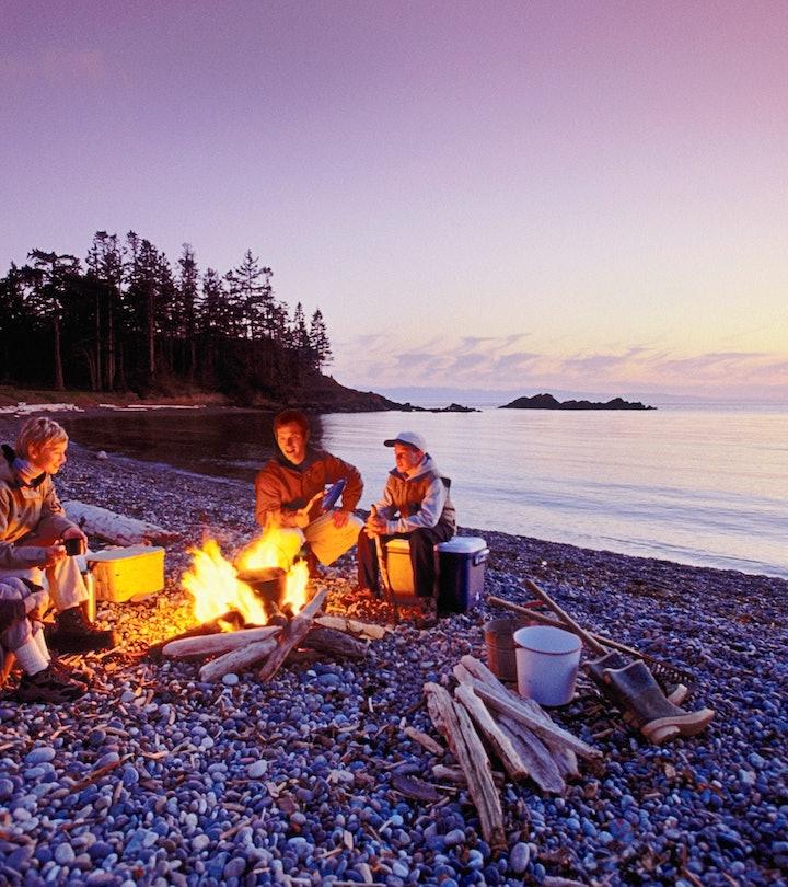 friends cooking around a campfire