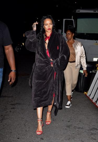 Rihanna in a robe.