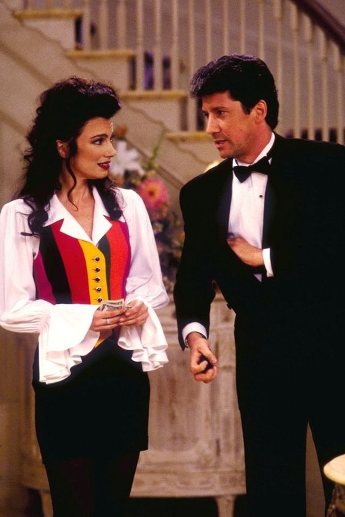 The Nanny's Fran Fine wearing a white pirate short, multi-colored striped vest and black pants, styl...