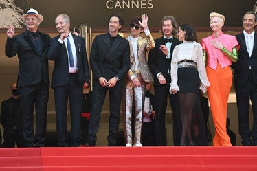 The cast of The French Dispatch posing on the Cannes Film Festival red carpet
