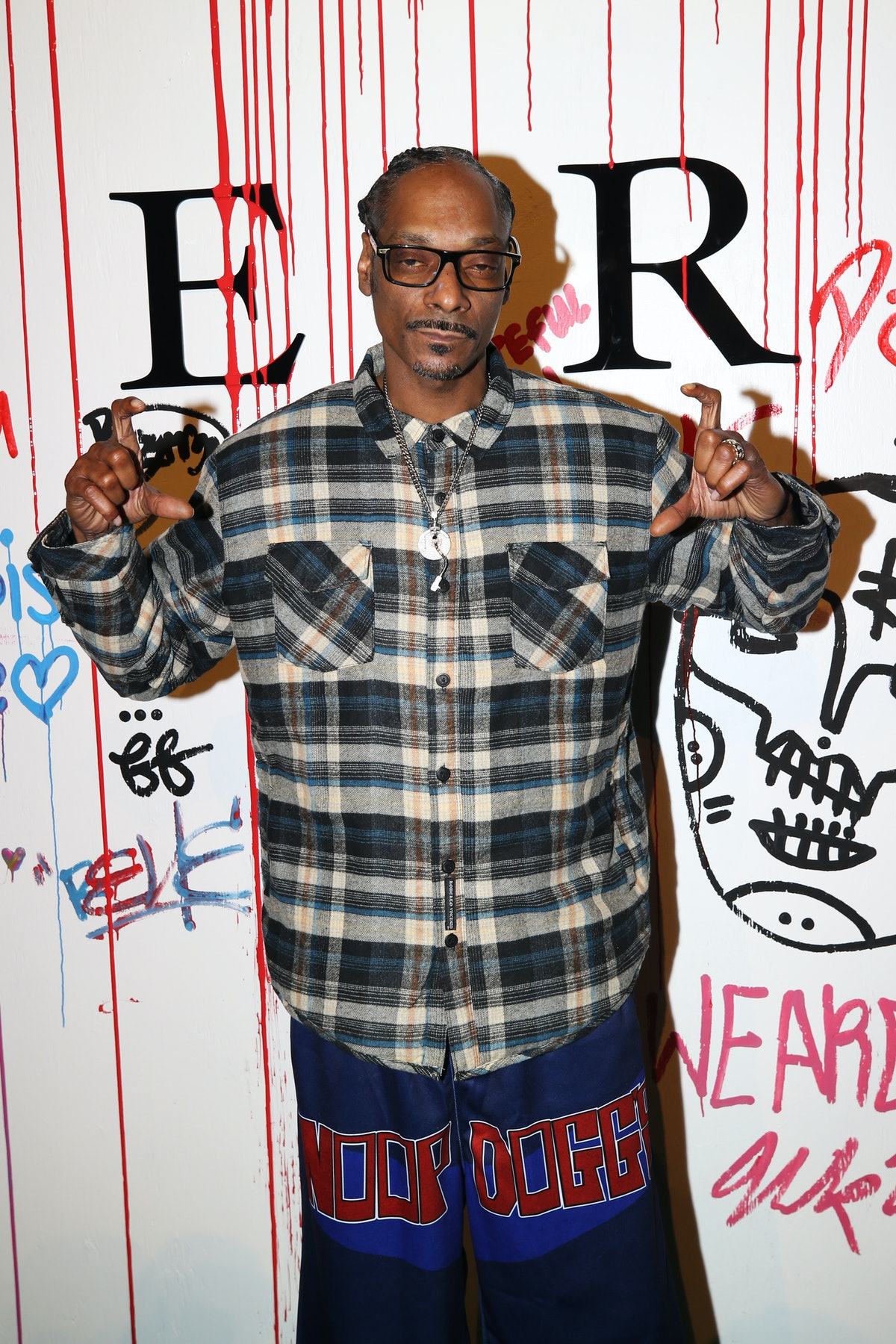 Snoop Dogg wearing a flannel
