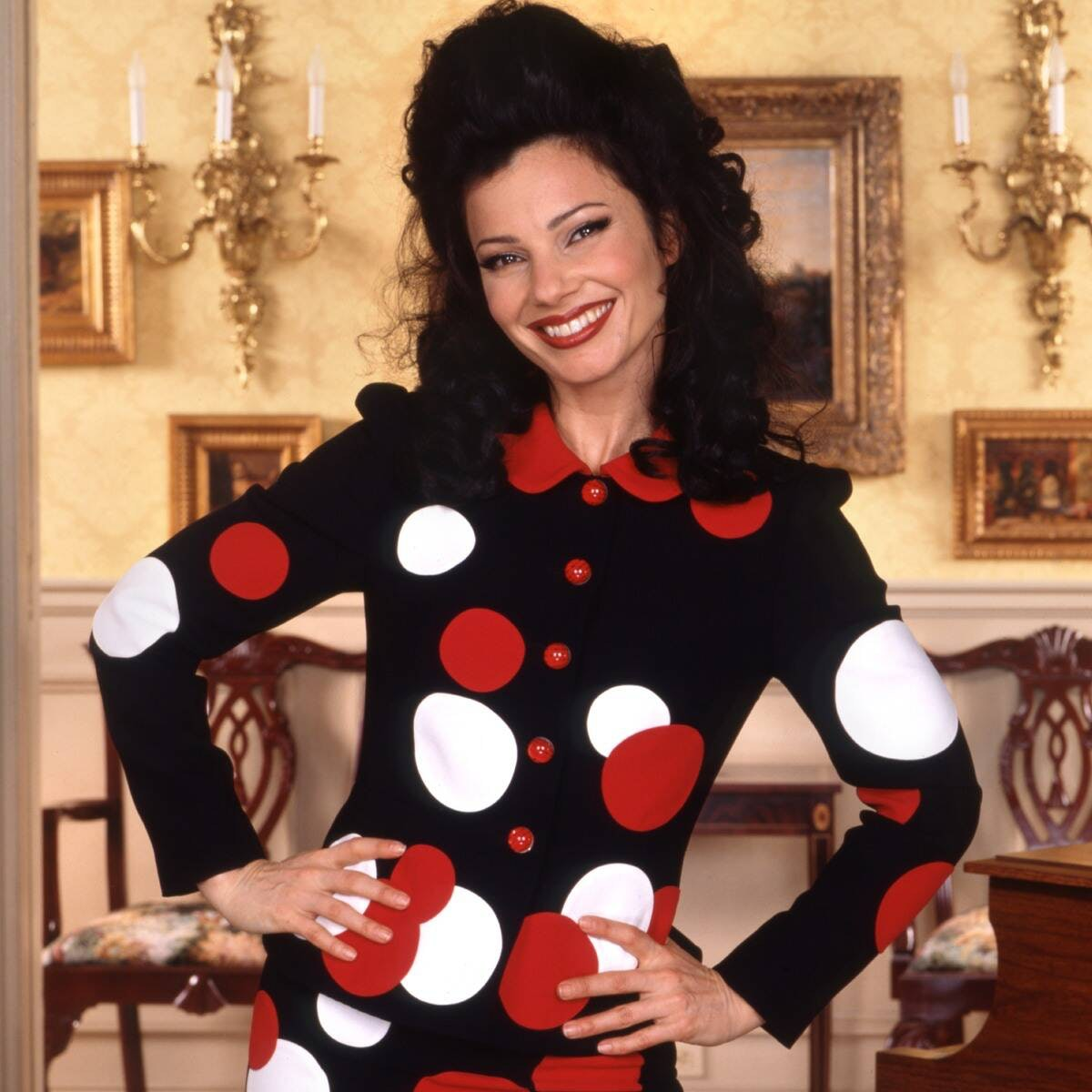 Fran Drescher poses as 'The Nanny's Fran Fine in a black suit with red and white buttons and polka d...