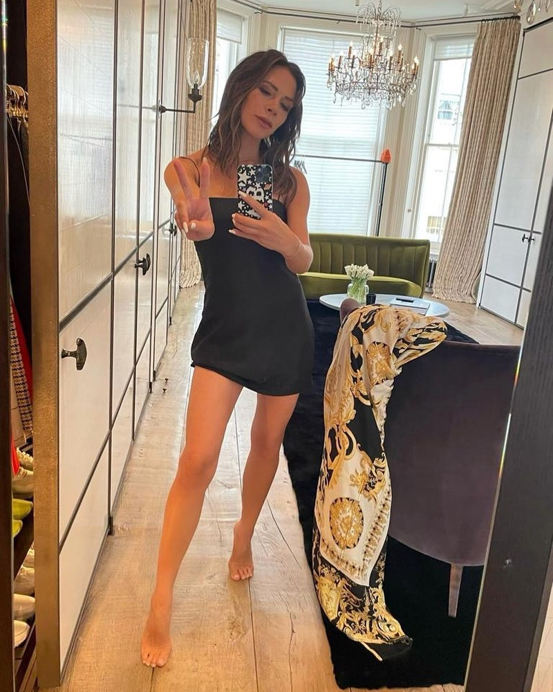 Victoria Beckham wearing a black mini dress.