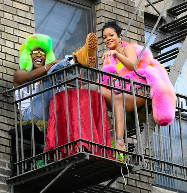 Rihanna on a fire escape.