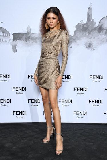 Zendaya in gold dress.