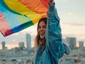 Young woman waving Pride flag, wearing a jean jacket in need of a rainbow quote, caption, or pun for...