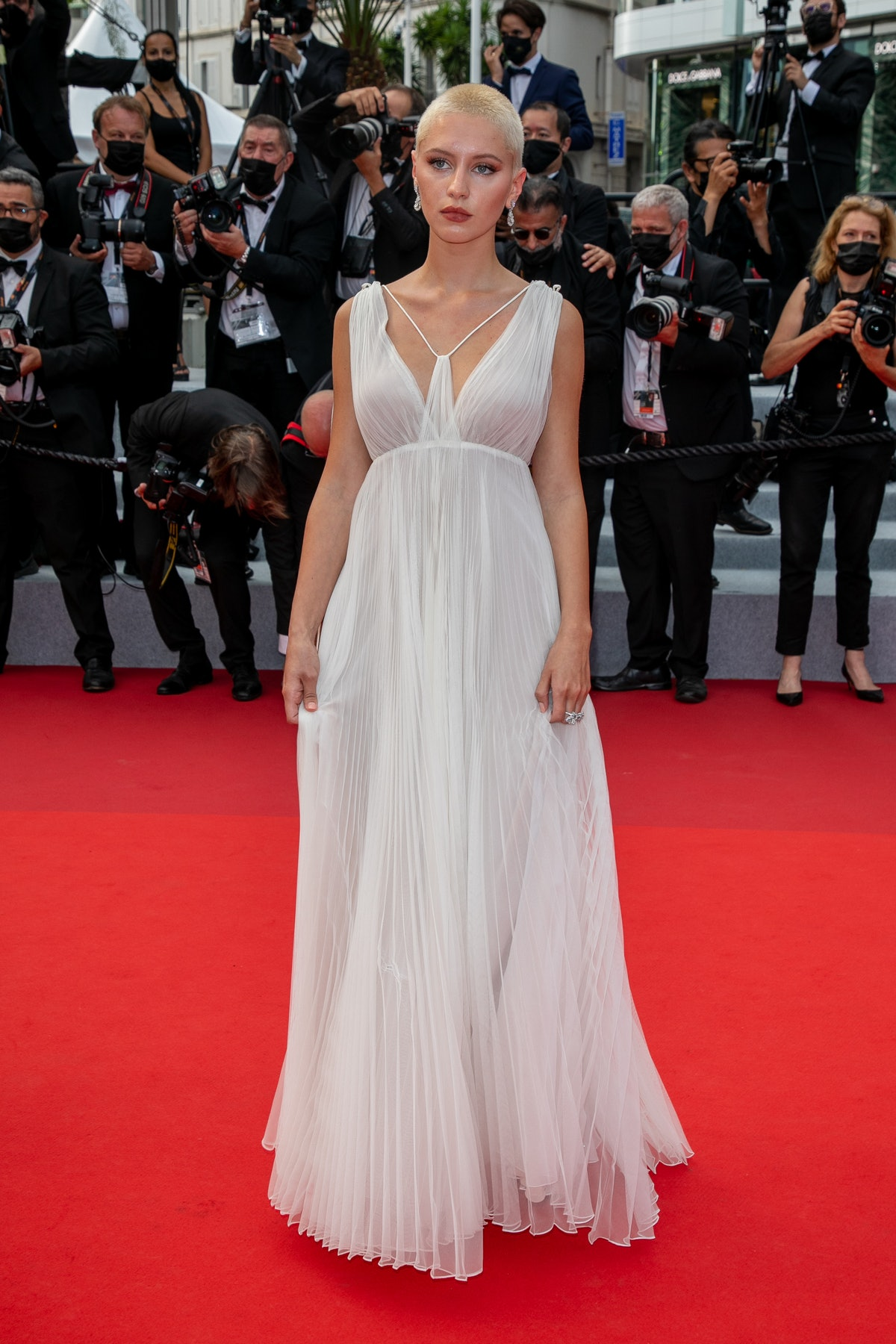 Iris Law wearing white Dior gown