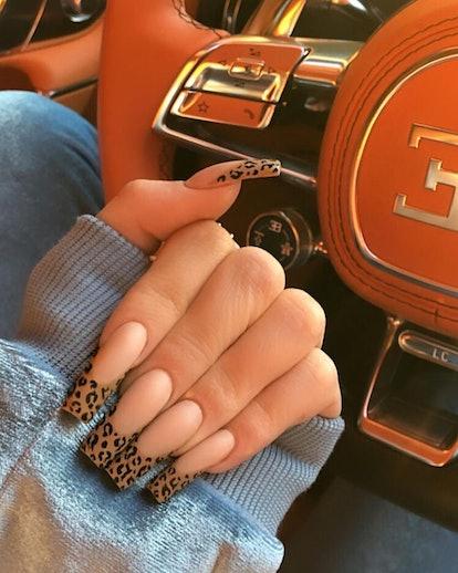 Kylie Jenner rocks a very '90s-era animal print manicure.