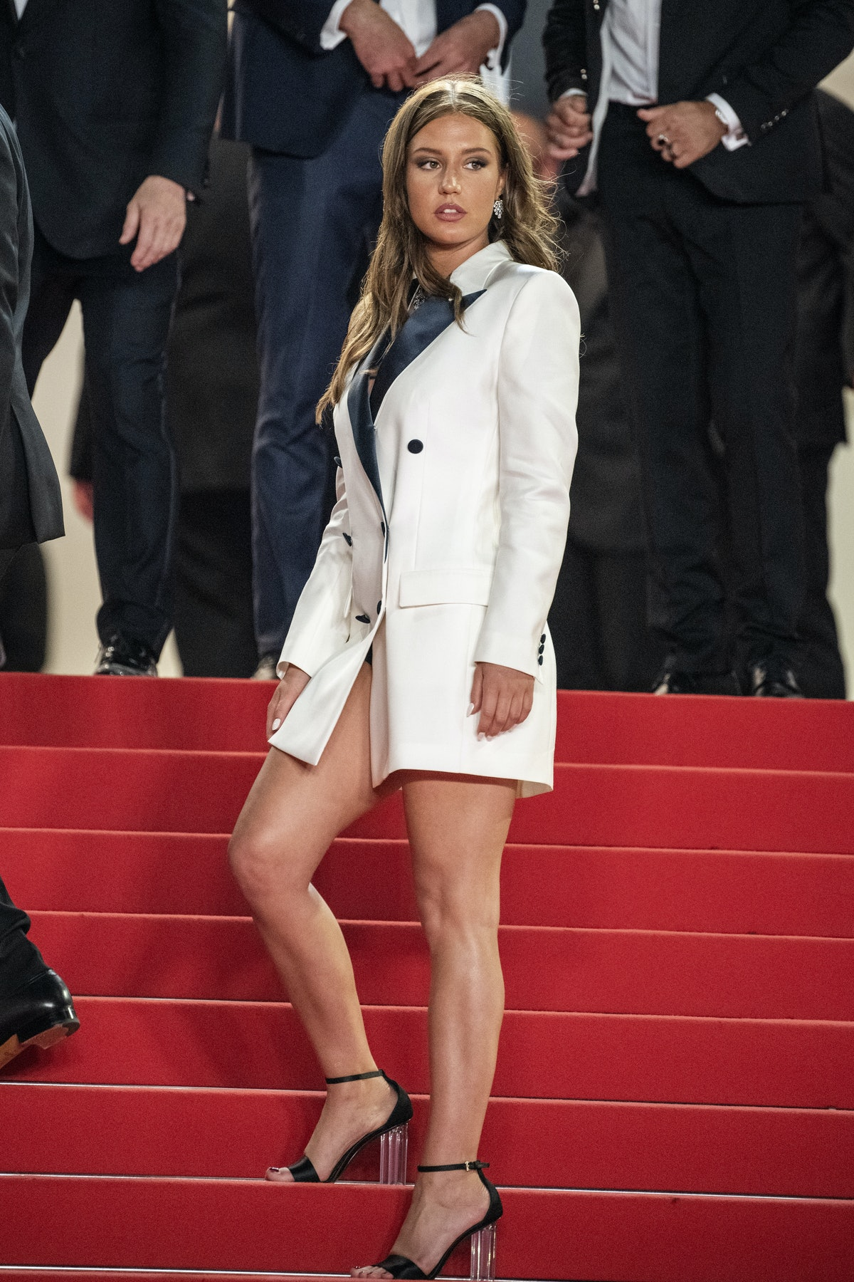 Adèle Exarchopoulos in a white suit and skirt