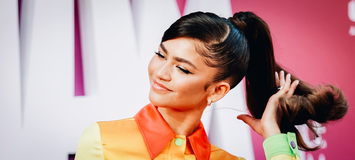 Zendaya flips her hair.