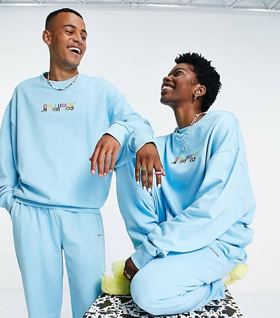 Unisex pulled in sweatshirt with embroidery in blue co-ord