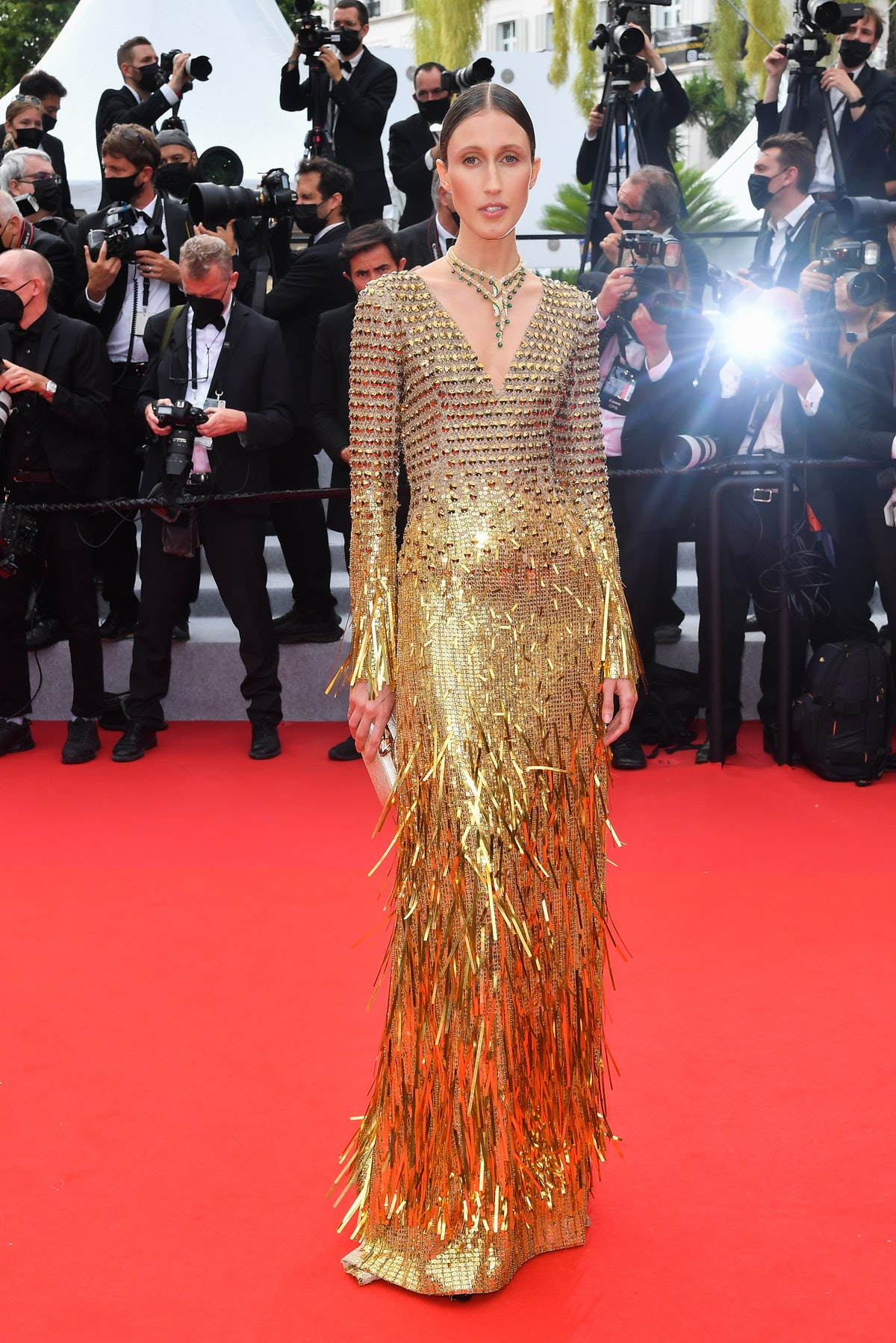 Anna Cleveland wearing shiny gold gown