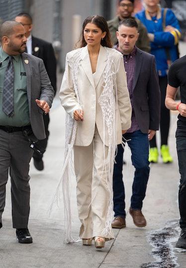 Zendaya in big beige suit.