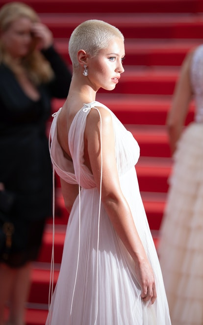 Iris Law showing off her new shaved head on the red carpet
