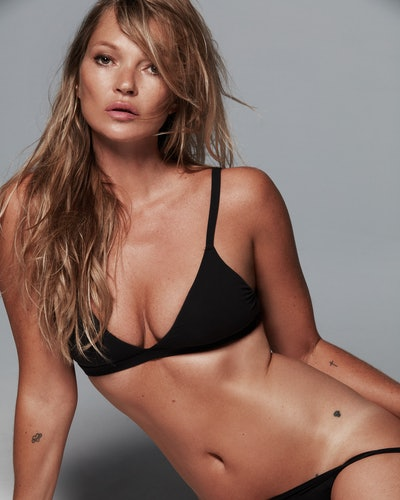 Kate Moss wears black bra and thong from SKIMS Fits Everybody collection in her recent SKIMS 2021 TV ad campaign.