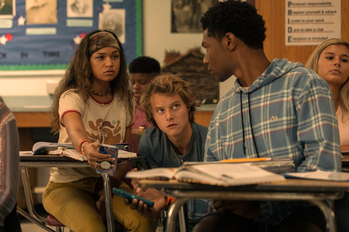 MADISON BAILEY as KIARA, RUDY PANKOW as JJ and JONATHAN DAVISS as POPE in Netflix's 'Outer Banks;