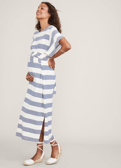 a white and gray ankle length wrap dress with boxy top and side slits