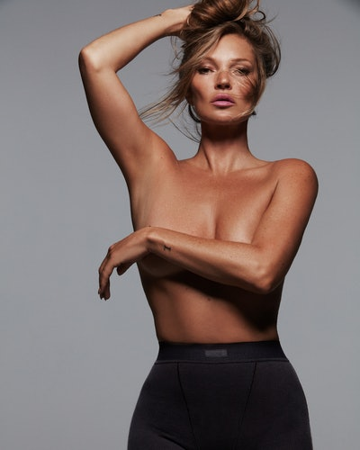 Kate Moss wears black boxer briefs from SKIMS Cotton collection in her recent SKIMS 2021 TV ad campaign.