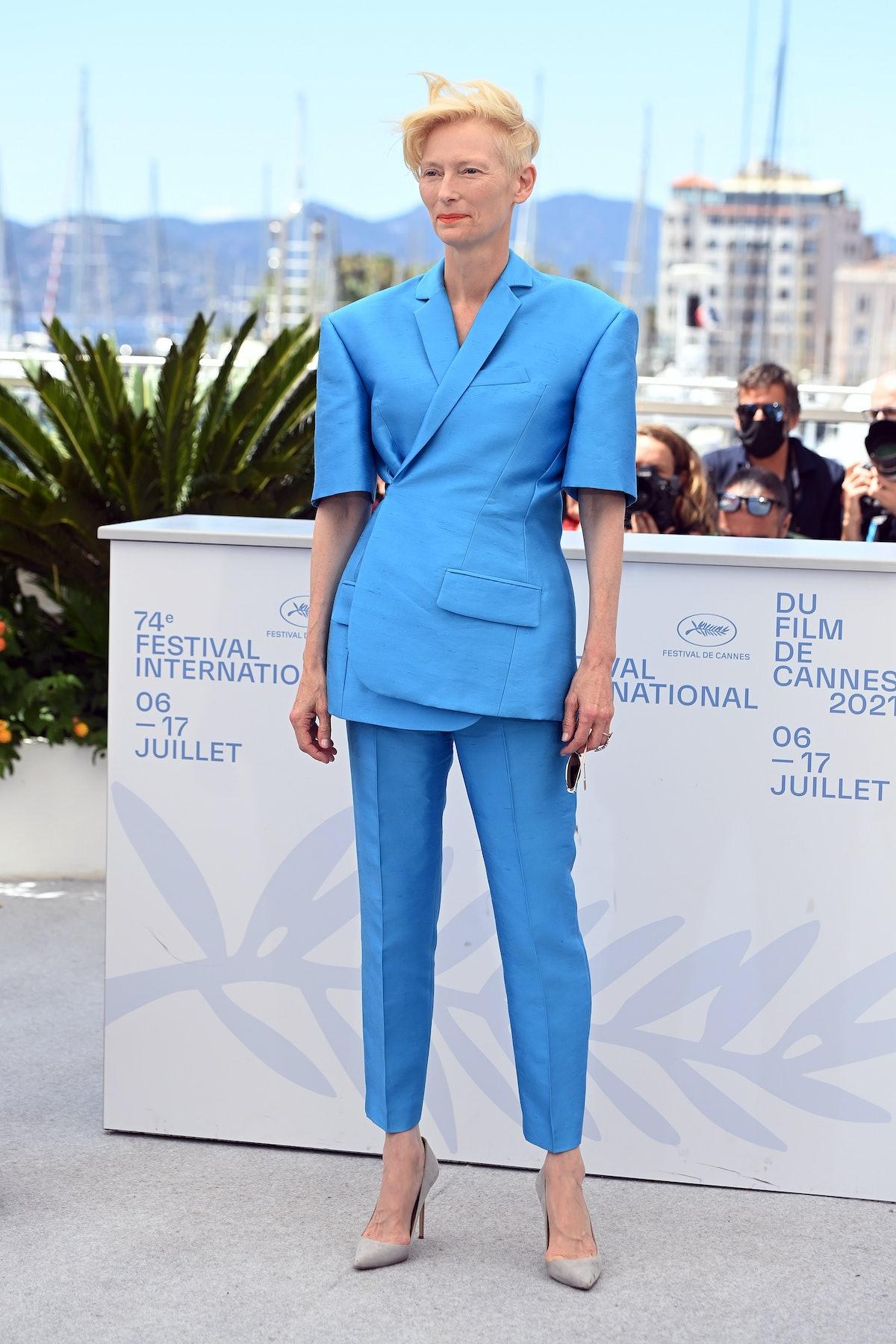 Tilda wearing a blue suit