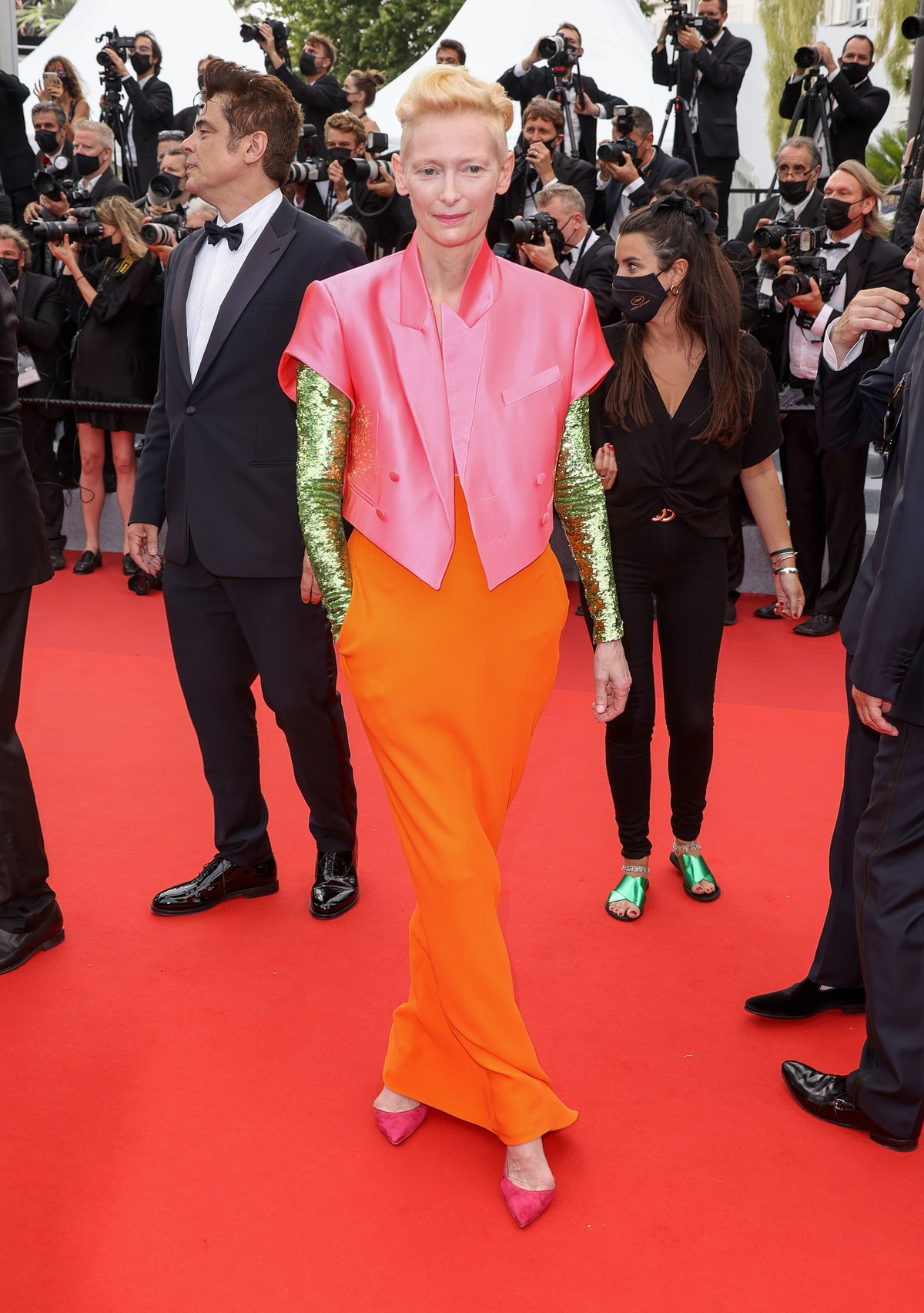 Tilda Swinton wearing a shiny gold pink and orange ensemble