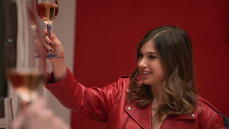 Miriam Haart raising a glass of wine.