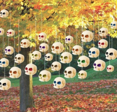 Decorative skulls hanging from a tree