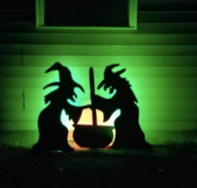 Light up witches leaning over cauldron