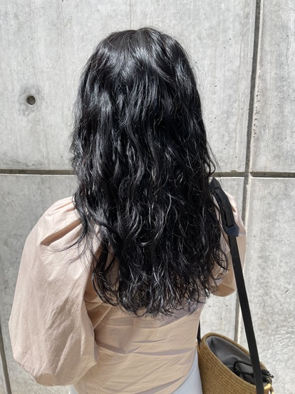 back view of my beach wave permed hair