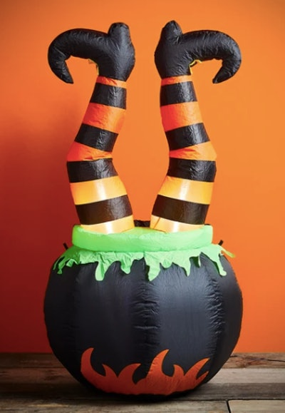 Blow up witches legs in cauldron