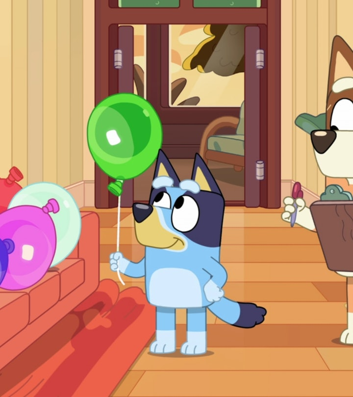 Still from 'Bluey'; Bluey holding balloon with mom who is holding a clipboard