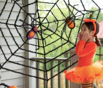 outdoor faux spiderweb decoration