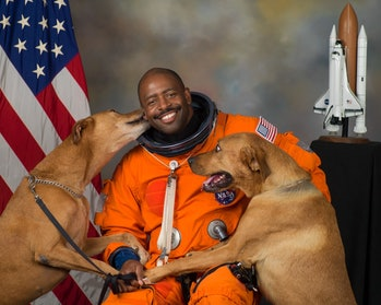 Astronaut Leland Melvin with his two dogs.
