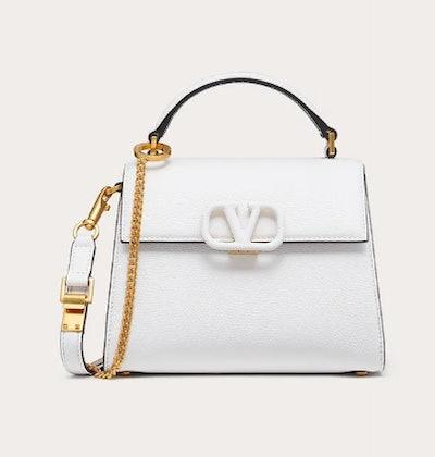 Valentino's Mini VSLING Grainy Calfskin bag in optic white.